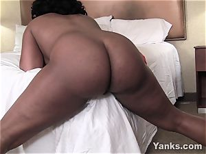 Sydnee Capri pounds the corner of the bed to orgasm