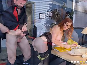 Dani Jensen frolicking with trunk in the office