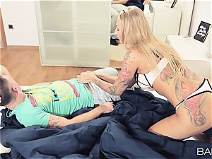 Blondes Kayla Green and Olive Bell share a weenie