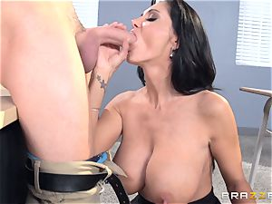 buxomy lecturer Ava Addams is pummeled by her college girl