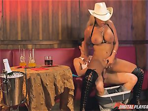 Bridgette B in scorching leather boots and pummels on a bed